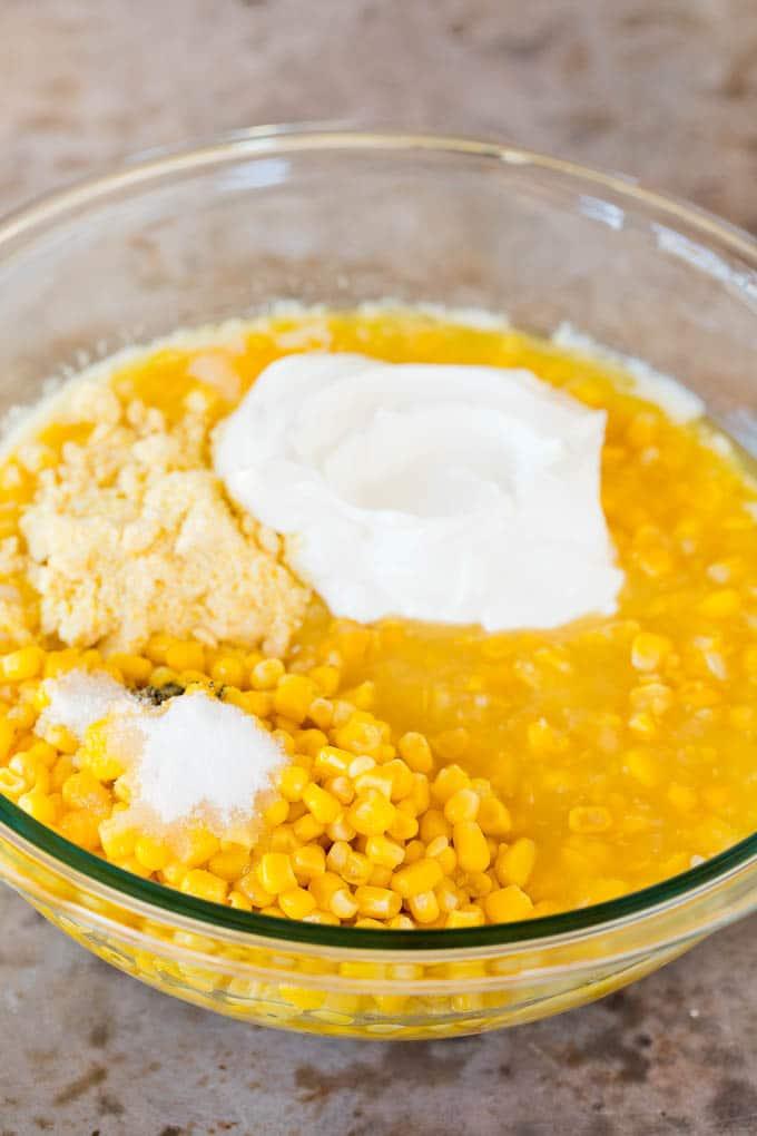 Corn, sour cream, corn muffin mix and sugar in a bowl.
