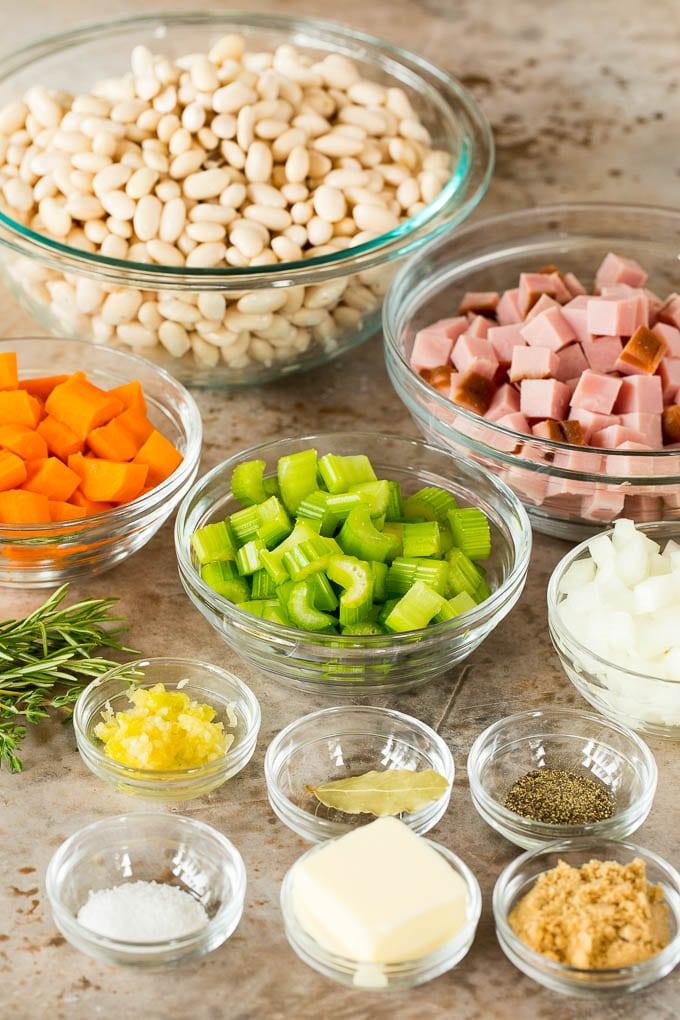 Bowls of ingredients such as ham, vegetables and seasonings.