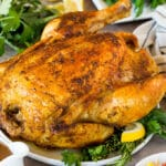 An Instant Pot whole chicken served with green beans and pilaf.