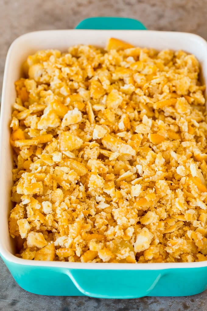 Sweetened pineapple in a casserole dish with a cracker topping.