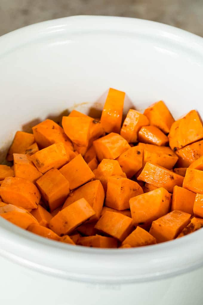 Diced sweet potatoes in a slow cooker.