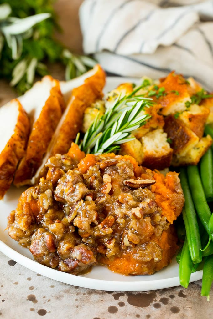 A plate of crock pot sweet potato casserole served with turkey and stuffing.