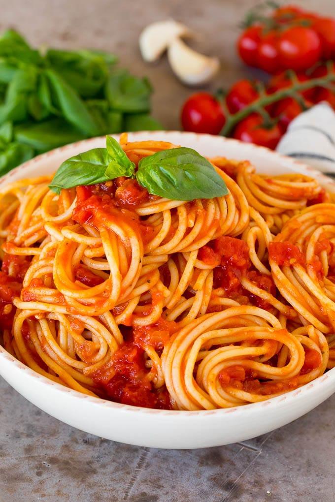 Homemade marinara sauce served with spaghetti.