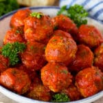 A bowl of Italian meatballs in tomato sauce.