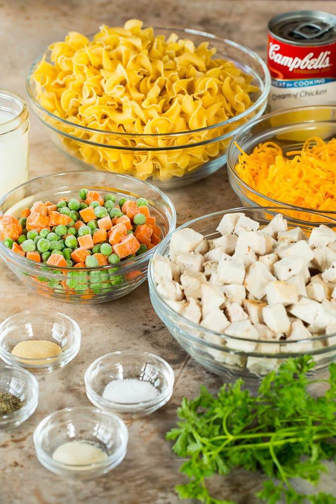Bowls of turkey, vegetables, noodles and seasonings.