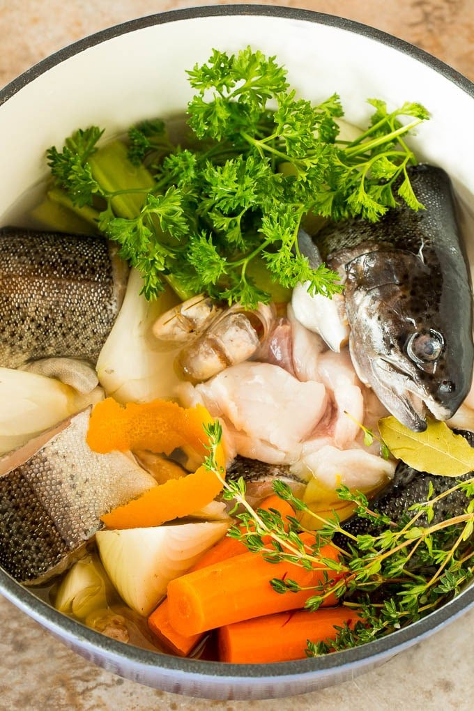 A pot of fish trimmings and vegetables for stock.